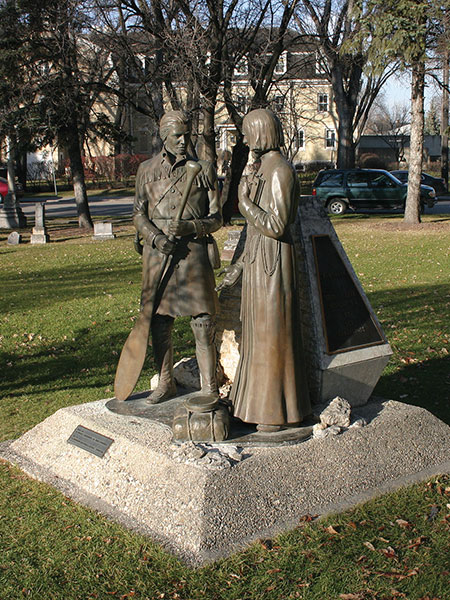 A monument in the St. Boniface Cathedral Cemetery on Tache Avenue, erected by La Société historique de Saint-Boniface, features sculptures of missionary Jean-Pierre Aulneau and Jean Baptiste Gaultier La Vérendryé, commemorating them and 19 others killed on an island in Lake of the Woods on 6 June 1736.