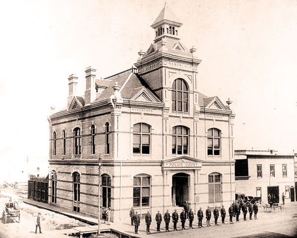 Members of Winnipeg's new police force stand in front of the Police Court on James Street, 1886.