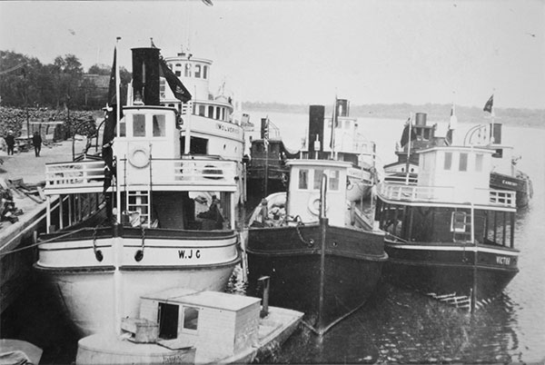 W. J. Guest docked at Selkirk with the Nothern Fish Company fleet  including the Carberry, Tempest, Victor, and Wolverine